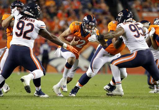 Denver Broncos quarterback Paxton Lynch (12) is sacked by Chicago Bears defensive end Roy Robertson-Harris (95) and defensive tackle John Jenkins (92) during the second half of a preseason NFL football game, Saturday, Aug. 18, 2018, in Denver. (AP Photo/Jack Dempsey)