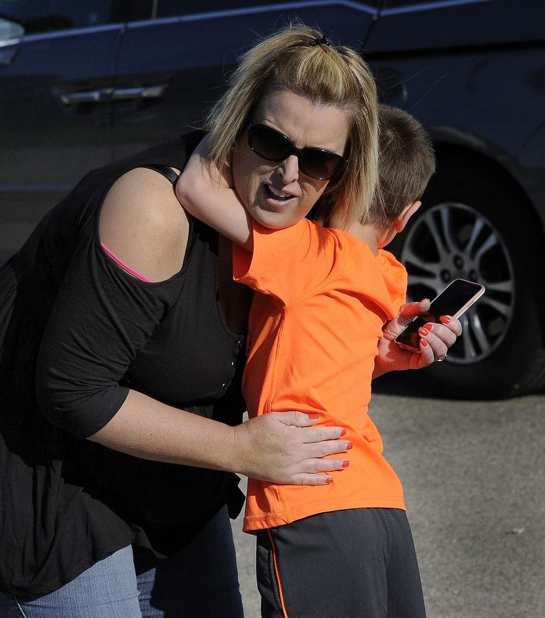 It doesn't get any easier to let go for Meg Doucet of Buffalo Grove, whose son, Aidan, gives her a long goodbye Wednesday on his first day at Longfellow Elementary School in Buffalo Grove.