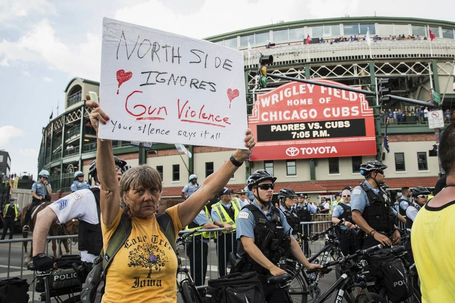 Anti-violence protesters rally outside Wrigley Field shortly before the Aug. 2 Cubs game after marching and shutting down Lake Shore Drive near Belmont in Chicago. Now the group plans a Labor Day march on Interstate 190 near O'Hare International Airport.
