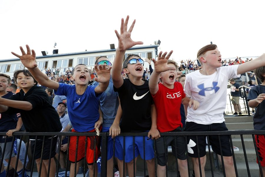 Kids scream for T-shirts as the Chicago Bears held a practice at Vernon Hills High School's Rust-Oleum Field Wednesday evening.
