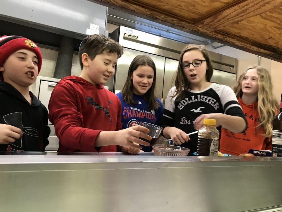 Students at Congregation Kneseth Israel's religious school engage in interactive education in the kitchen.