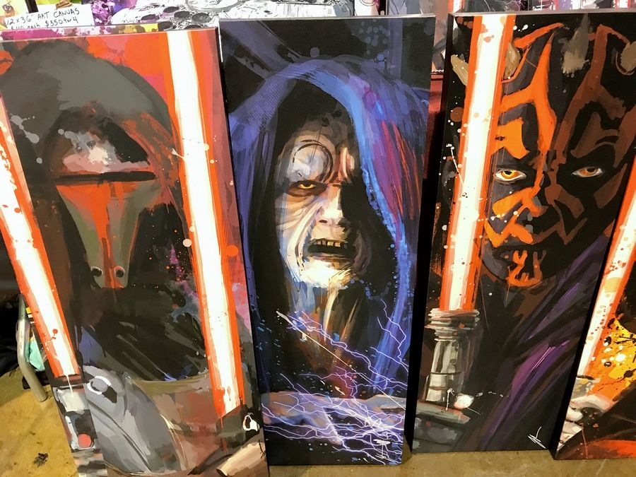"Jason Oakes of San Antonio is selling his paintings of iconic pop culture heroes and villains like these ""Star Wars"" characters this weekend at Wizard World Chicago in Rosemont."