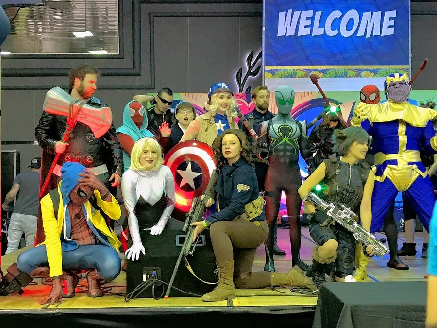 Wizard World Chicago attendees cosplaying as Marvel heroes and villains pose Friday for the crowds gathered in the lobby of the Donald E. Stephens Convention Center in Rosemont.