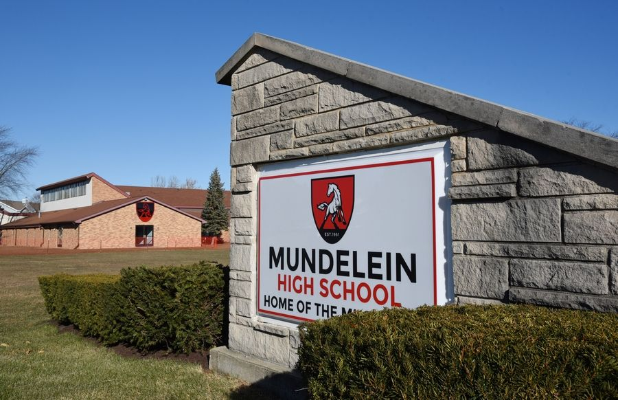 Mundelein High School Superintendent Kevin Myers and other administrators now have offices in a building on campus that used to be a church.