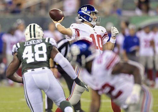 11267b33883 New York Giants quarterback Eli Manning (10) passes against the New York  Jets during