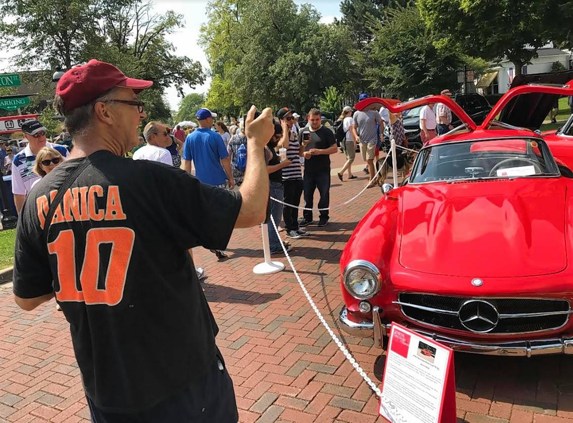 P.J. Ryan of Glen Ellyn captures the image of a Mercedes-Benz Gull Wing on Sunday during the Geneva Concours d'Elegance classic car show in downtown Geneva.