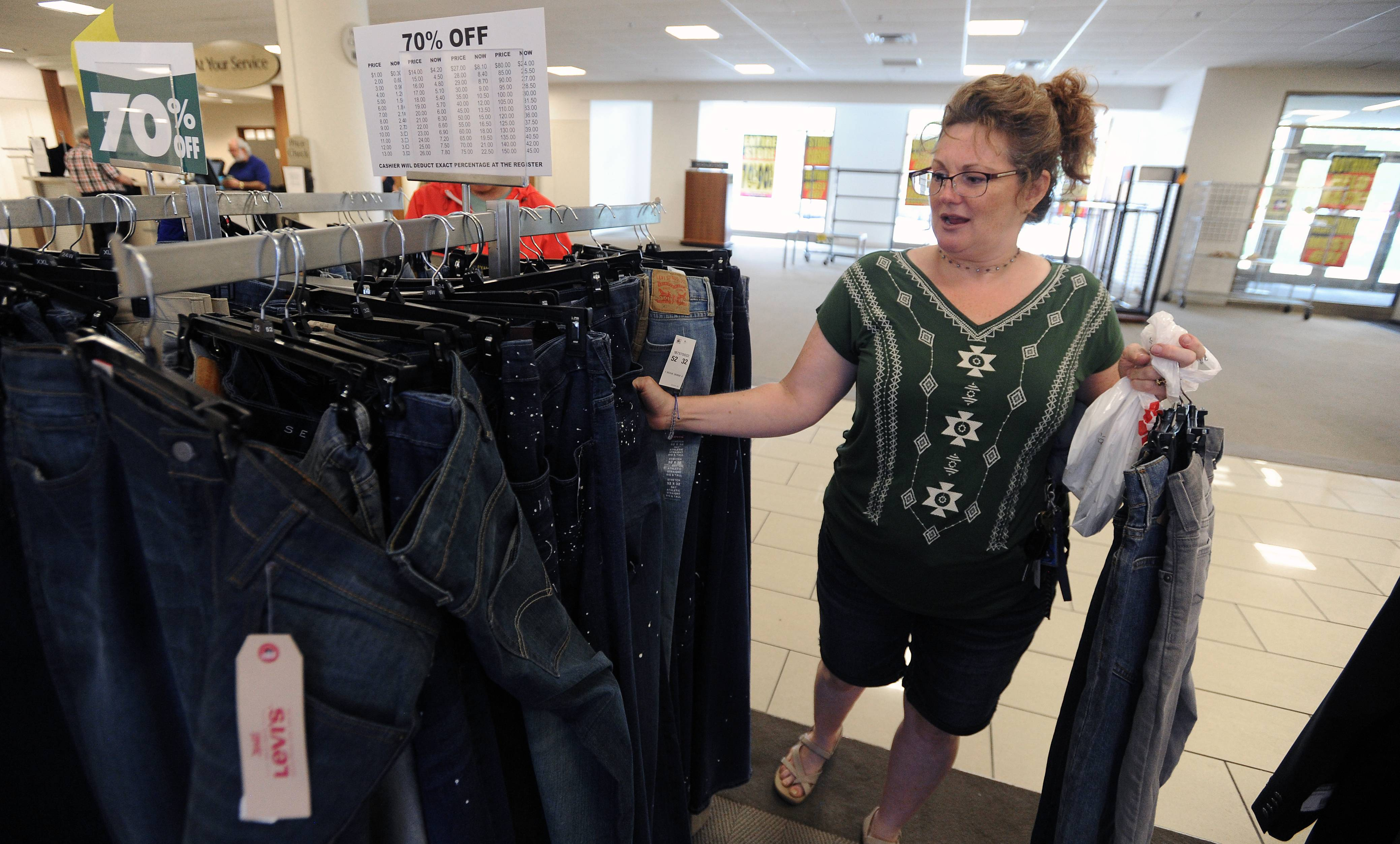 "Christine Hecht of Arlington Heights shops for bargains on the last day for the Carson's Pirie Scott store at Randhurst Mall in Mount Prospect and recalls that this was the place she always came to shop for nice clothes. ""This is the place that I registered for my wedding, to get good china."""