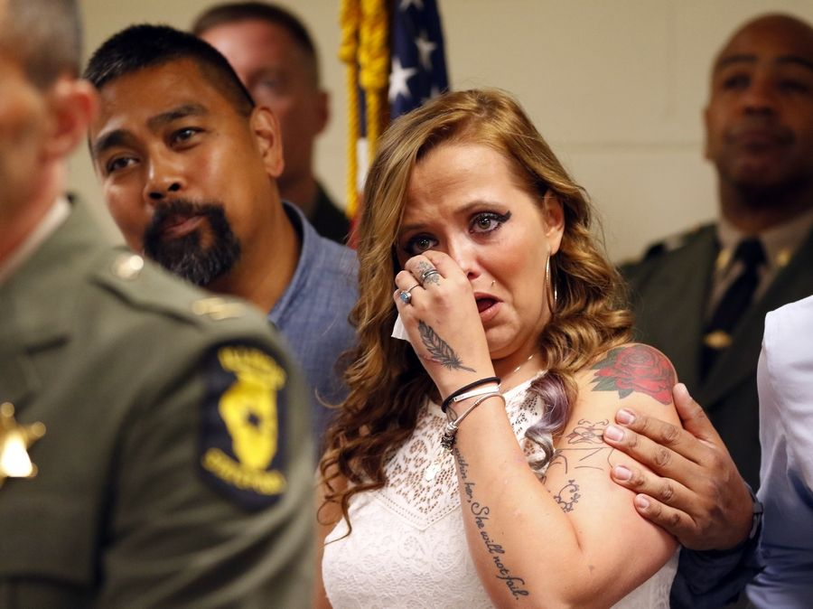 Joanna Girmschied reacts with tears Wednesday as Illinois State Police and Illinois Tollway officials recognize 11 people for helping save her life.