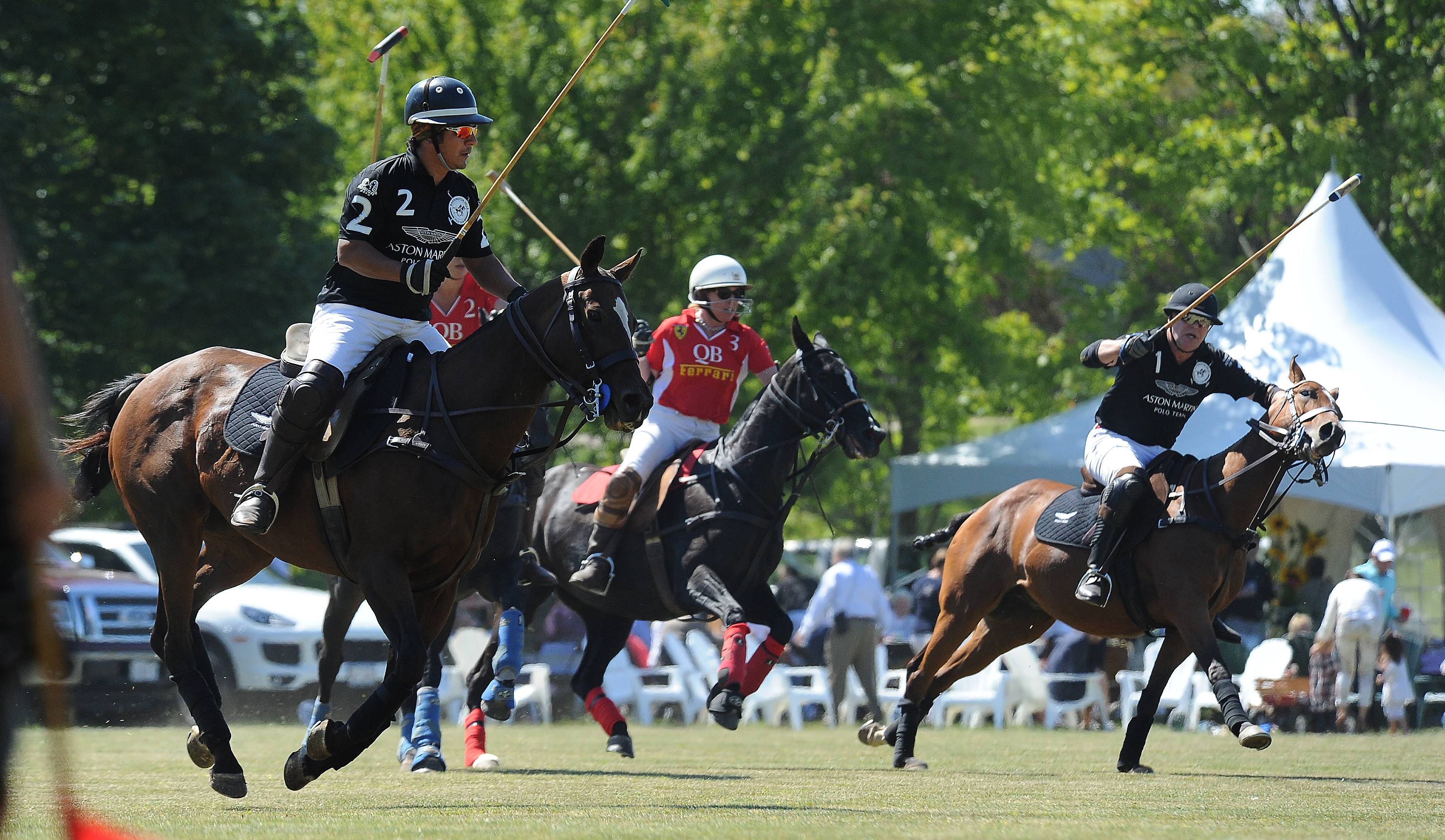 The Aston Martin Polo Team (men) and the Quintessential Barrington Polo Team (women) play at the 13th annual LeCompte Kalaway Trailowners Cup Polo Event in Barrington Hills.