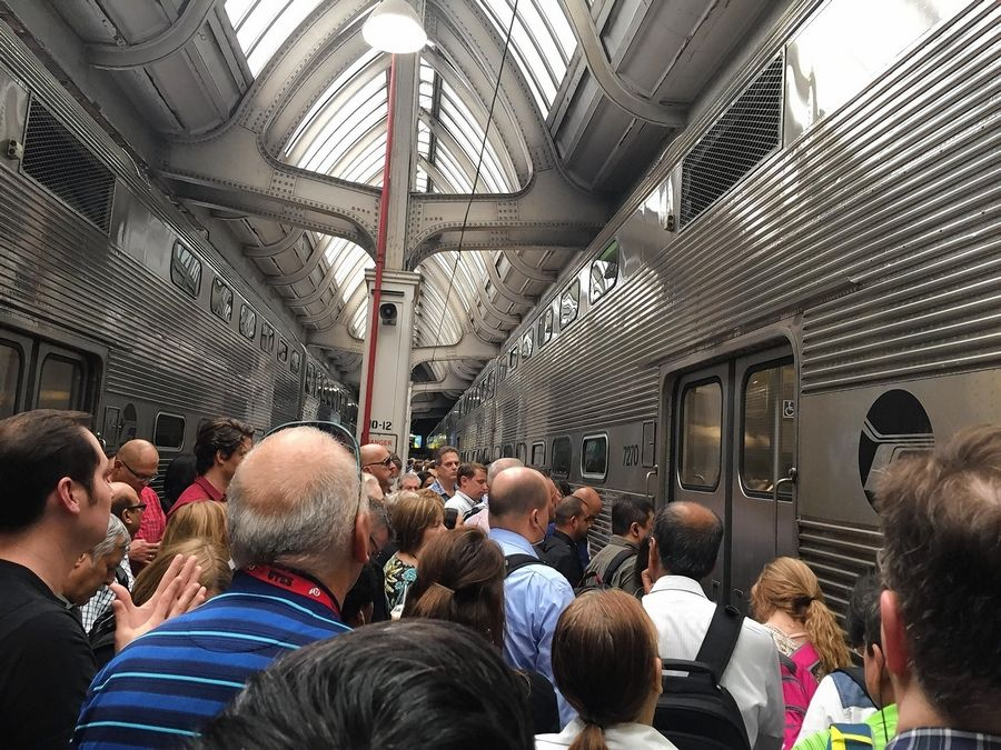 Metra BNSF passengers squeeze onto trains at Union Station in Chicago to board in June. Service problems are riling U.S. Rep. Dan Lipinski.