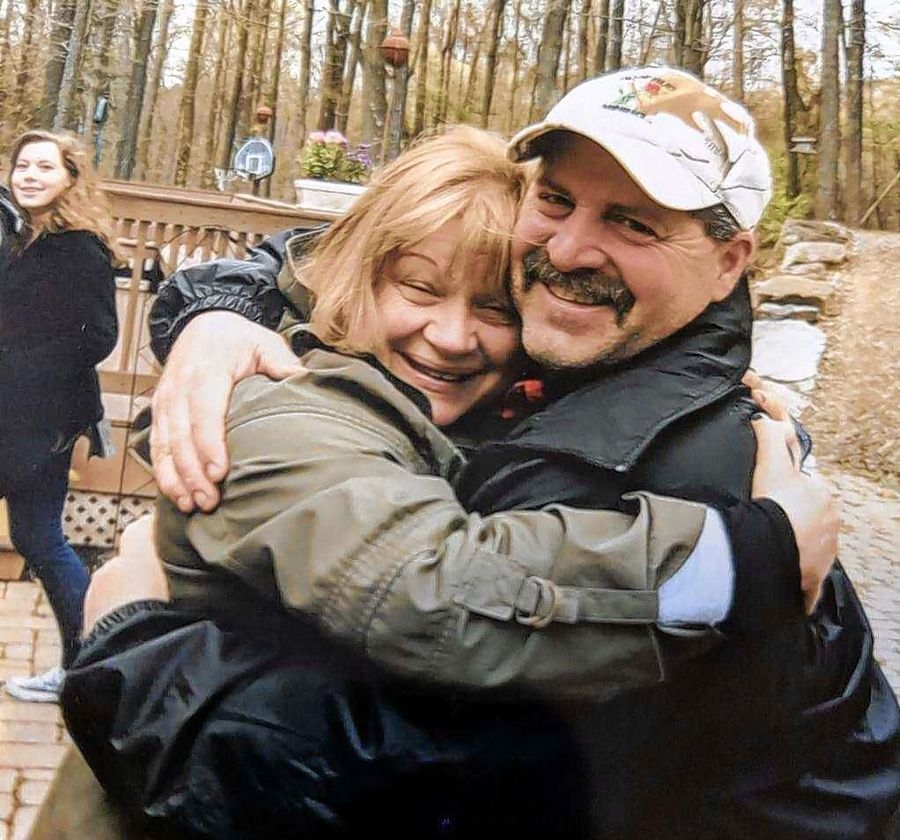 Sharing a hug after realizing that they also share a biological father, Wauconda's Shirley Wojcicki hugs her half-brother, Mike Sheredy. Sheredy and his siblings didn't know they had a half-sister until they discovered a letter after their mother died.