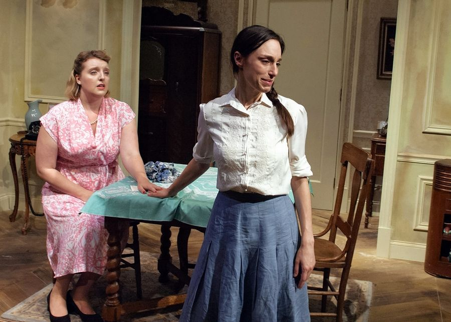 "Sisters Rose (Bri Sudia), left, and Lusia (Emily Berman) reconcile around their shared loss in TimeLine Theatre's revival of ""A Shayna Maidel"" by Barbara Lebow."