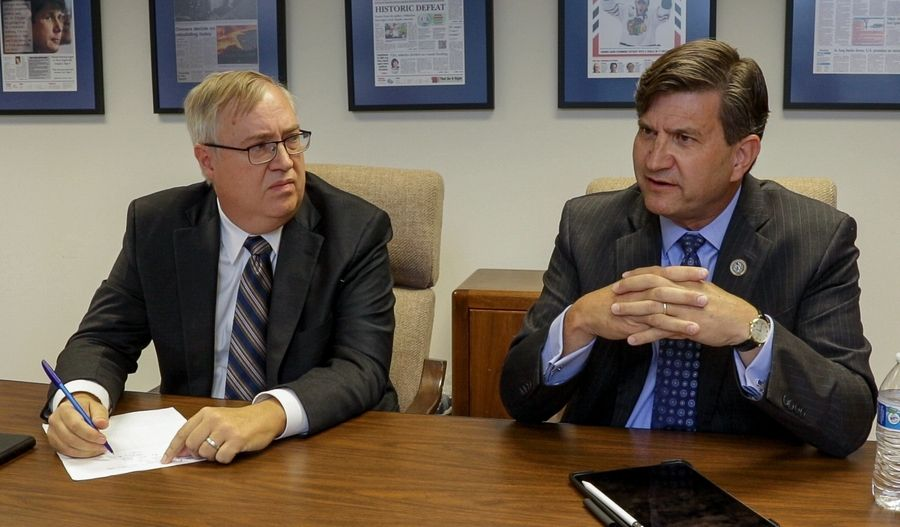 Republican congressional candidate Doug Bennett, left, and Democratic U.S. Rep. Brad Schneider discuss the issues facing Illinois' 10th District and the nation during a meeting with the Daily Herald editorial board.