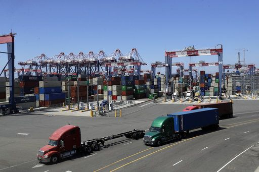 ADVANCE FOR USE FRIDAY, AUG. 31, 2018, AT 3:01 A.M. EDT AND THEREAFTER - In this Wednesday, Aug. 22, 2018, photo trucks travel along a loading dock at the Port of Long Beach in Long Beach, Calif. Between them, the California ports of Los Angeles and Long Beach account for a large amount of the seaborne goods that the United States imports from China, and the prospect of a widening trade war between the global giants has port executives and longshoremen worried.