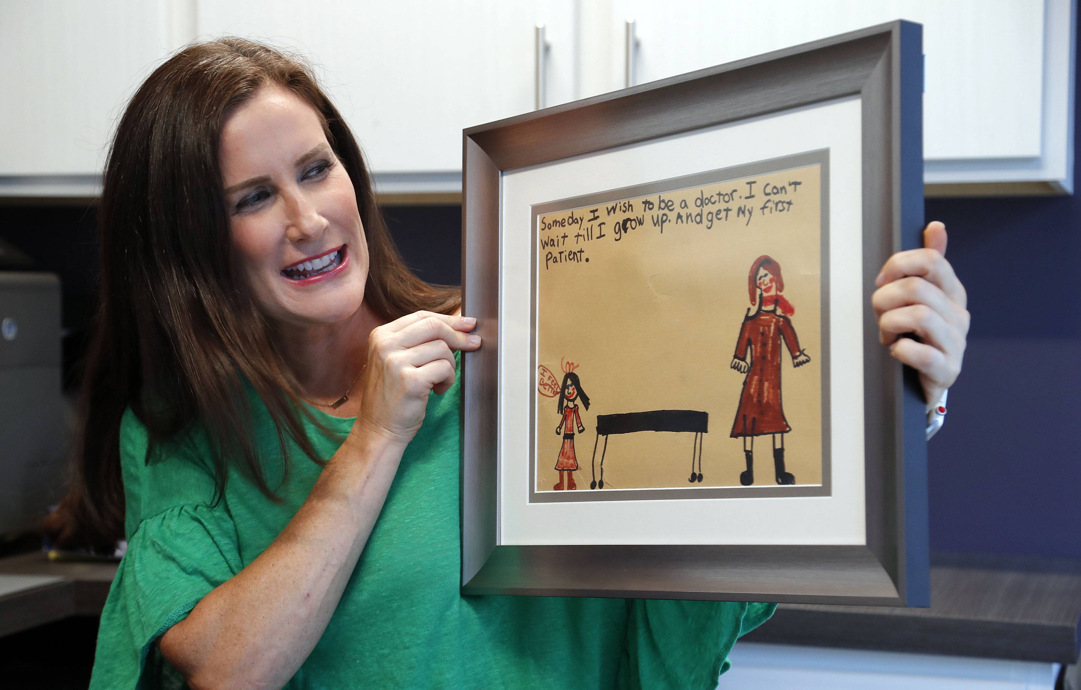 As a 7-year-old, Tara Troy drew this picture of her as a doctor helping a patient feel better. Now that drawing hangs in Dr. Troy's Comprehensive Gastrointestinal Health medical office opening this week in Northbrook.