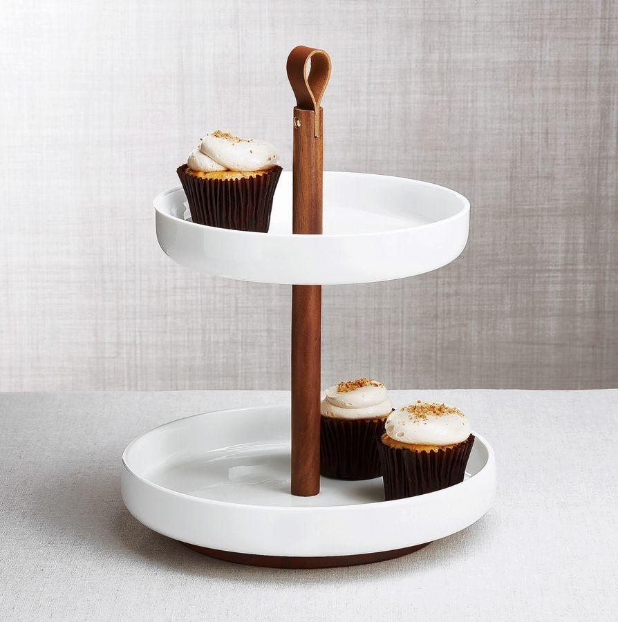 Crate & Barrel's Prospect collection of smart, contemporary serveware is designed by Ana Reza-Hadden. It combines wood, ceramic, metal and faux leather. The collection includes bowls, serving dishes and a decanter and tasting set.