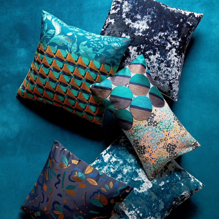 Rich, sumptuous hues, and a maximalist melange of patterns have West Elm's newest throw pillow collection hitting all the fall decor trends firmly on target.