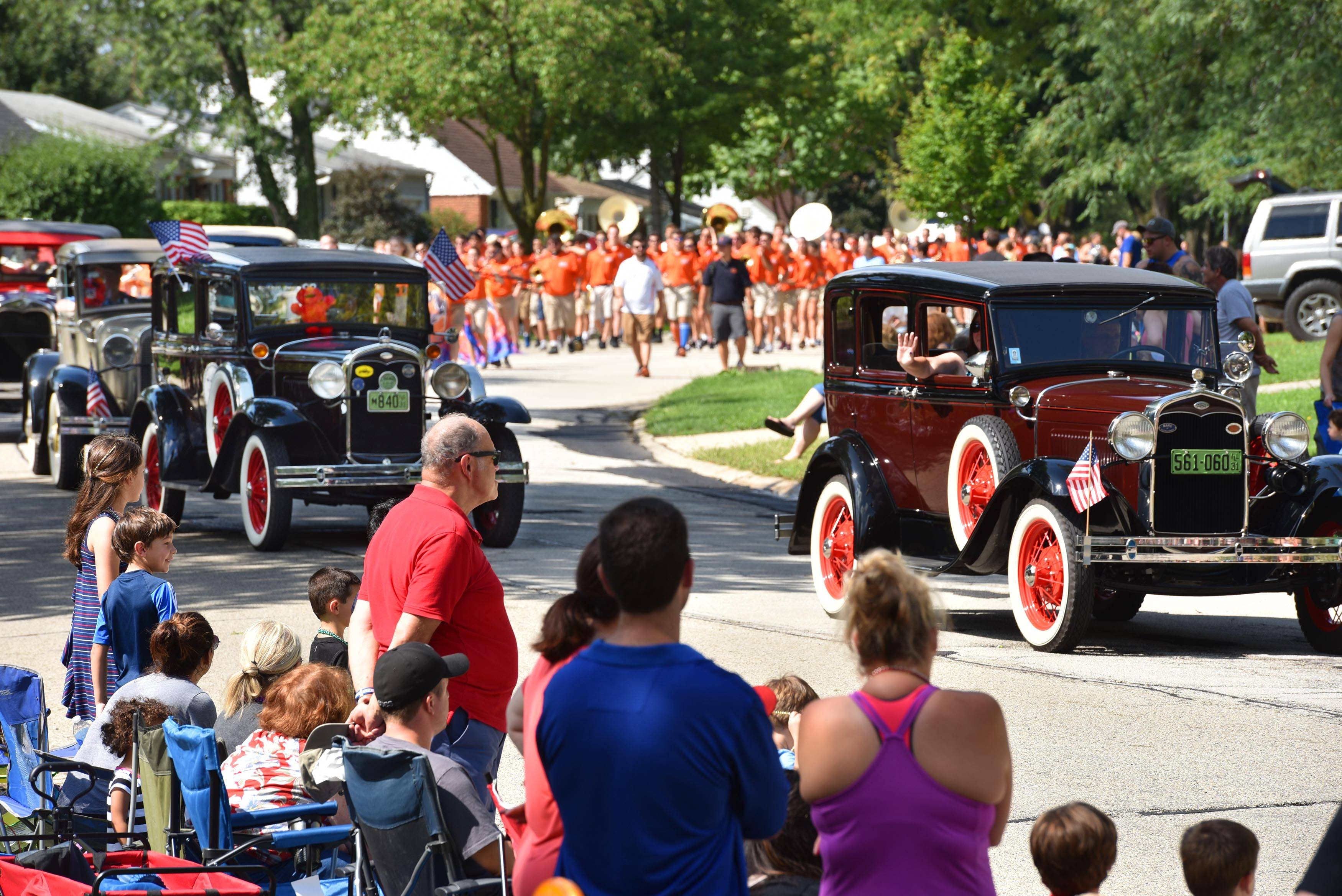 Cars with the Chain O' Lakes Model A Club of Antioch putter through Bernard Drive as the Buffalo Grove High School marching band follows Sunday morning at the Buffalo Grove Days parade.