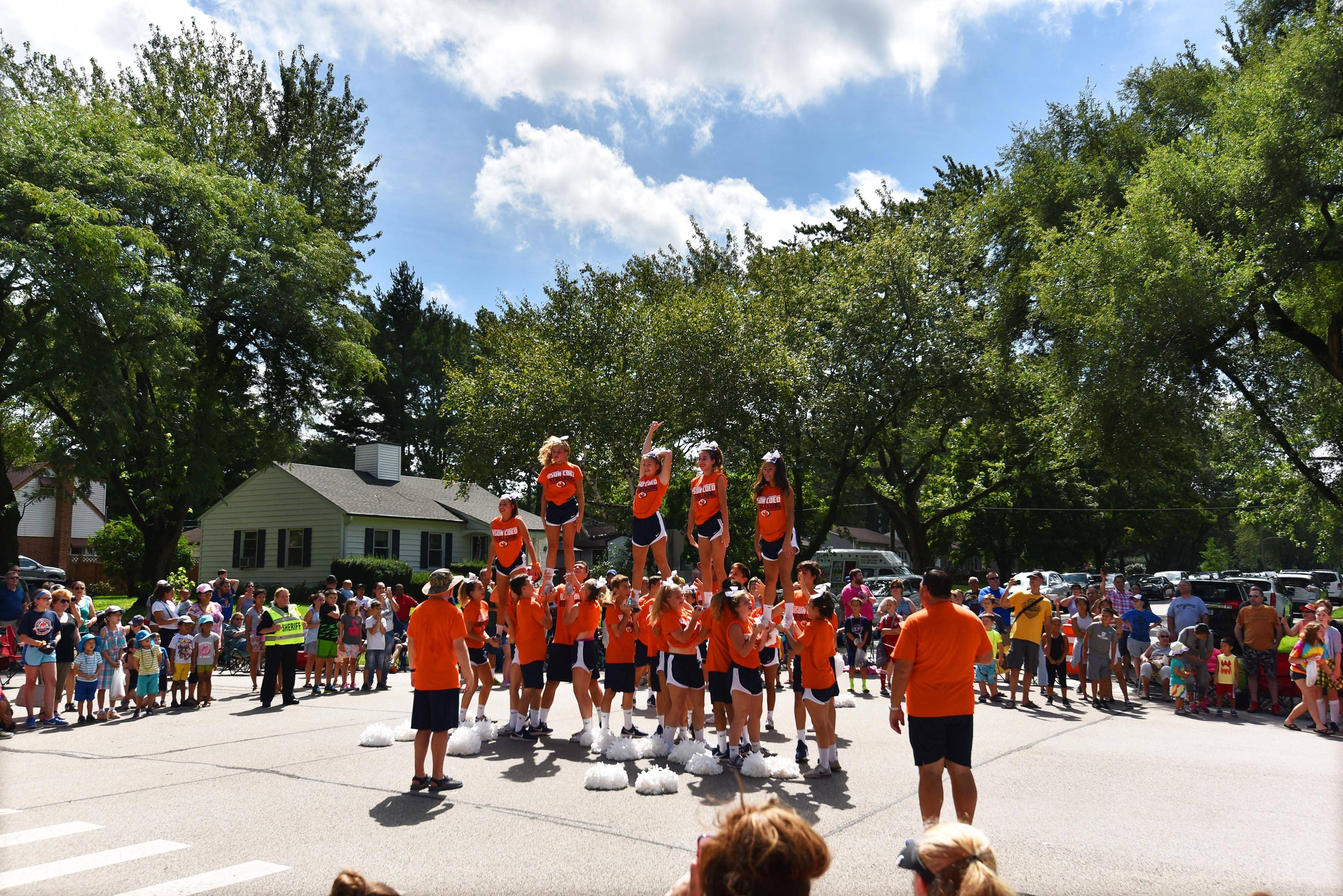 Buffalo Grove High School cheerleaders perform at the corner of Bernard Drive and Raupp Boulevard at the Buffalo Grove Days parade Sunday morning.