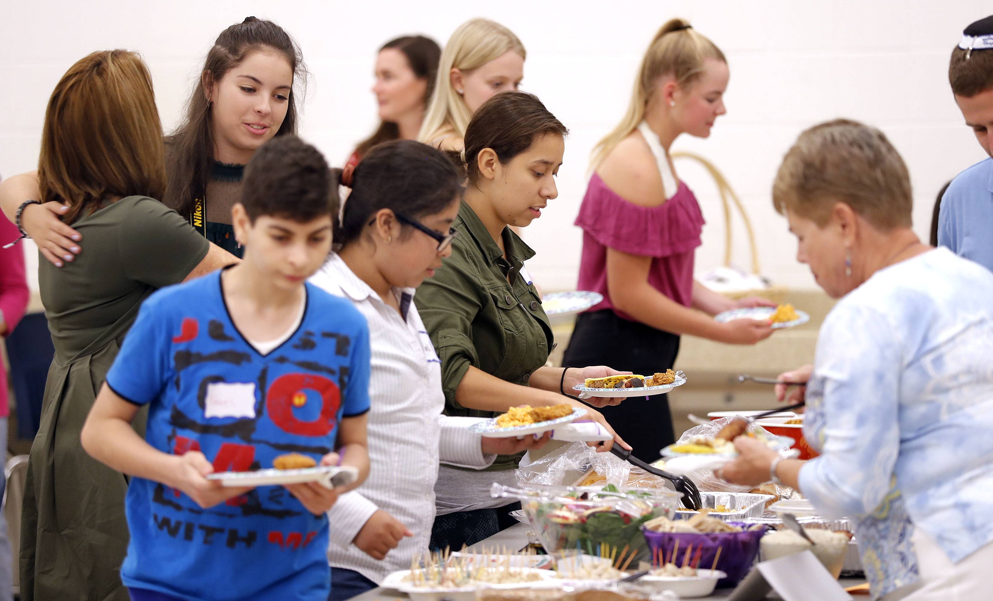 People enjoy a multicultural dinner during the Children of Abraham Coalition's seventh annual 9/11 interfaith Potluck For Peace Tuesday at St. Viator High School in Arlington Heights.