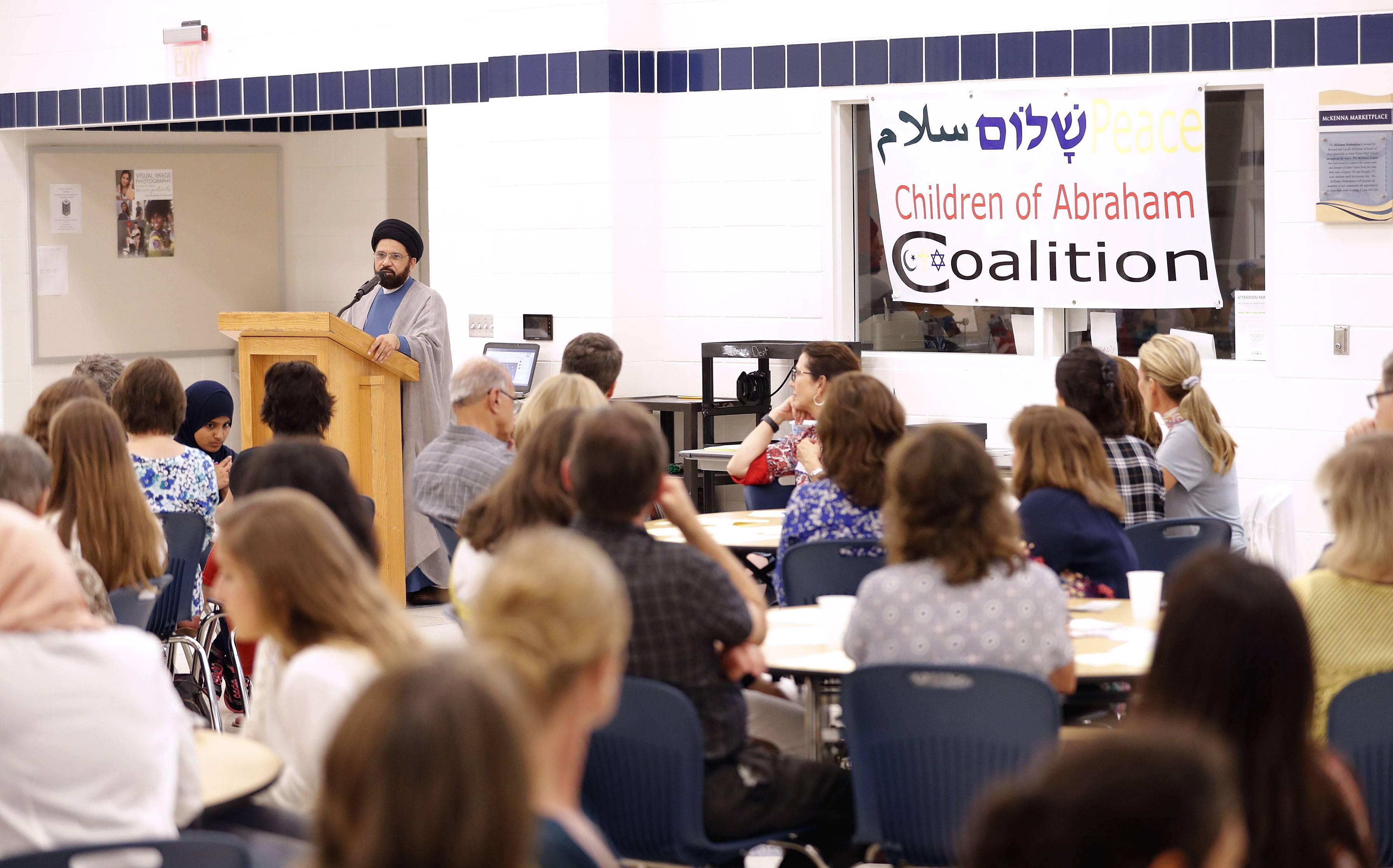Moulana Mehboob Mehdi of the Islamic Education Center in Glendale Heights speaks during the Children of Abraham Coalition's seventh annual 9/11 interfaith Potluck For Peace Tuesday at St. Viator High School in Arlington Heights.