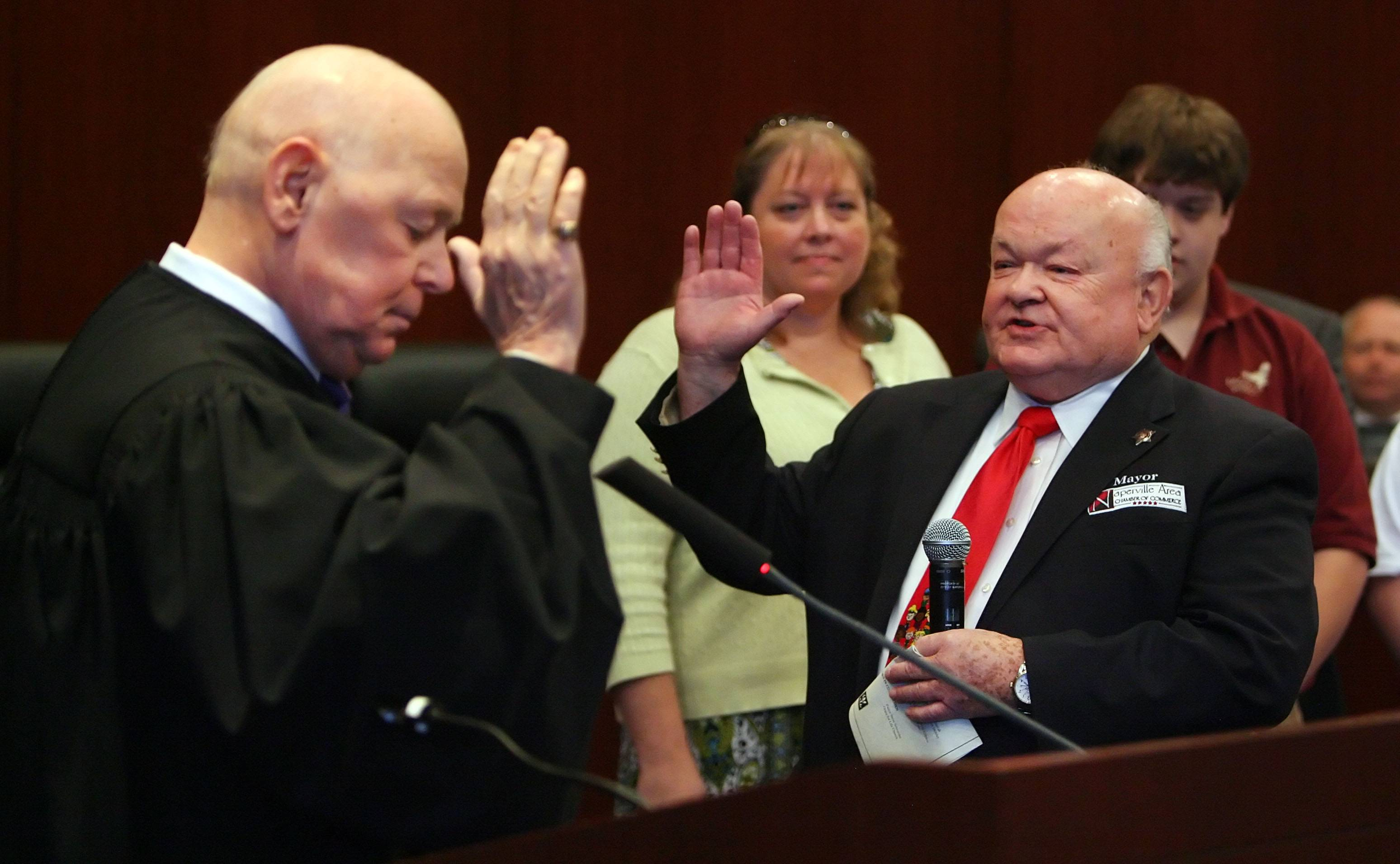 A familiar sight: George Pradel takes the oath of office. He served five terms as Naperville mayor, from 1995 to 2015.