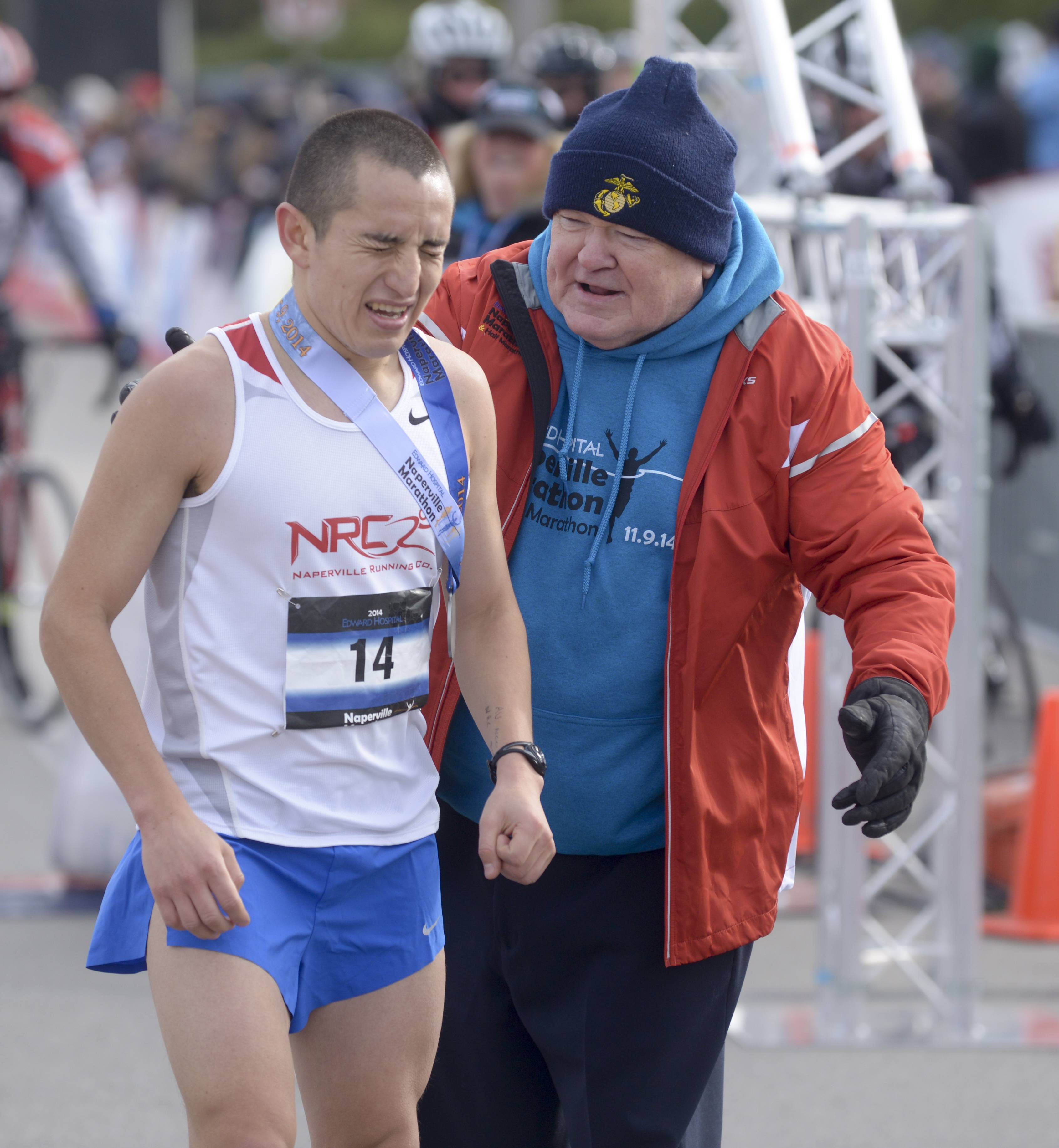 Pradel hands out medals at the finish line of the second annual Naperville Marathon.