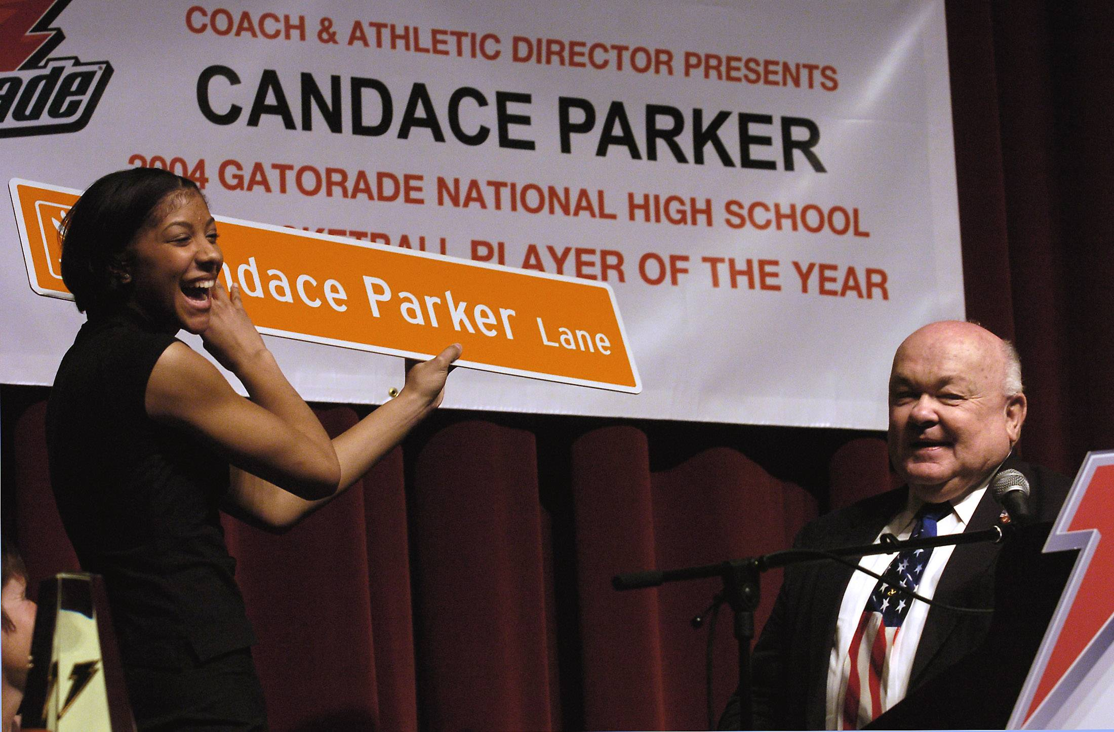 Pradel celebrates with Candace Parker, then a basketball star at Naperville Central High School, after she was named the 2004 Gatorade National High School Girls Basketball Player of the Year.