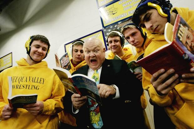 Pradel takes part in the Naperville Reads campaign with members of the Neuqua Valley High School wrestling team.