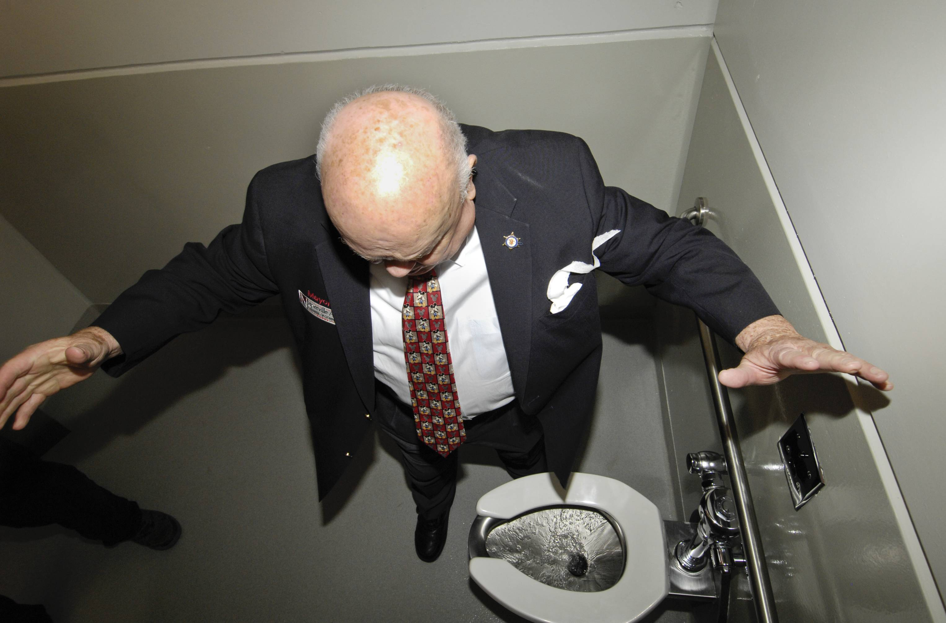 One of George Pradel's charms was that he never took himself too seriously. Here, he performs a ceremonial first flush for a new bathroom in Central Park.