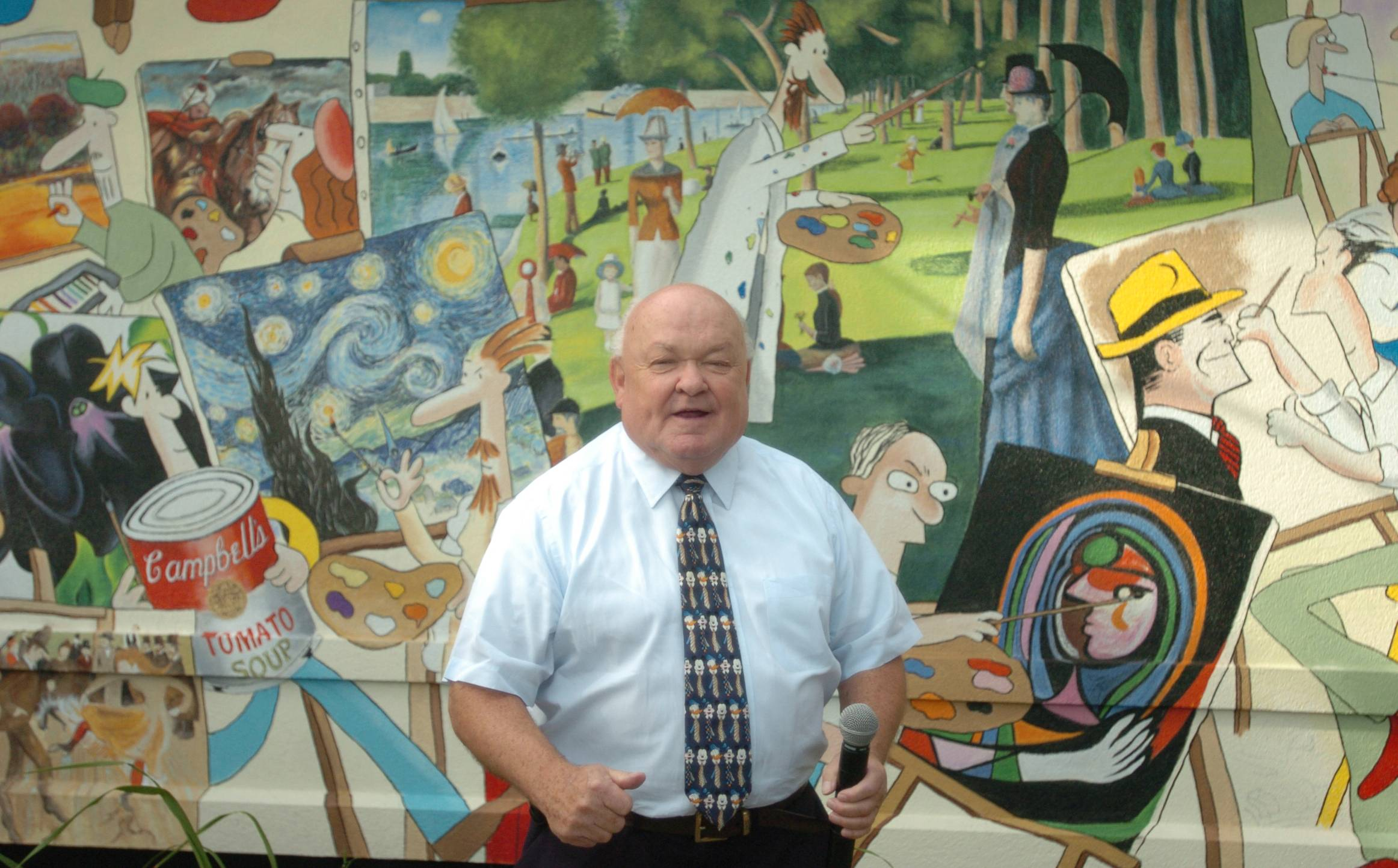 Pradel was a supporter of the arts, and area artists repaid the compliment by featuring him in murals and a sculpture.