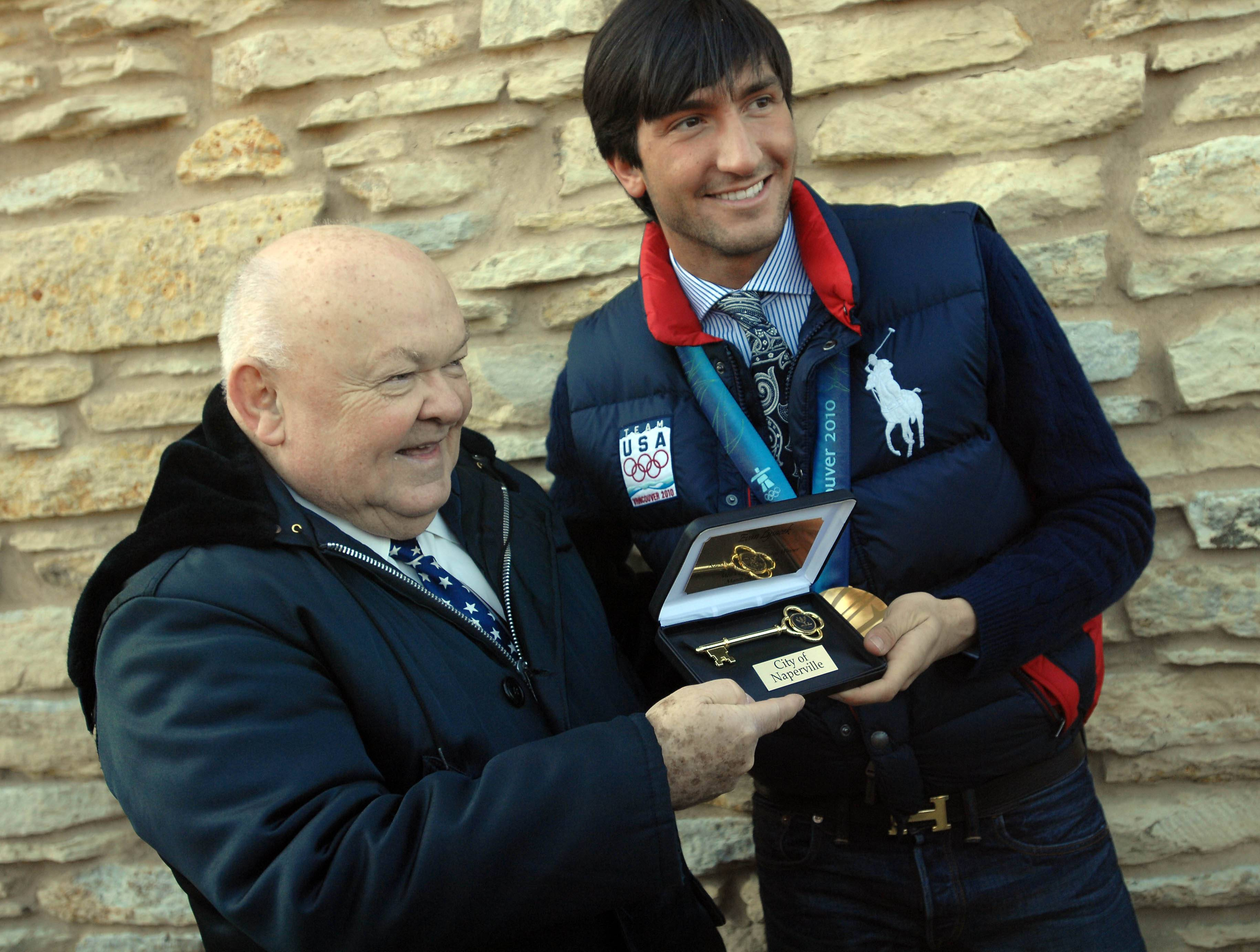 Pradel always was happy to celebrate the accomplishments of Naperville residents -- especially young people. Here, he gives Olympic gold medalist Evan Lysacek the key to the city.