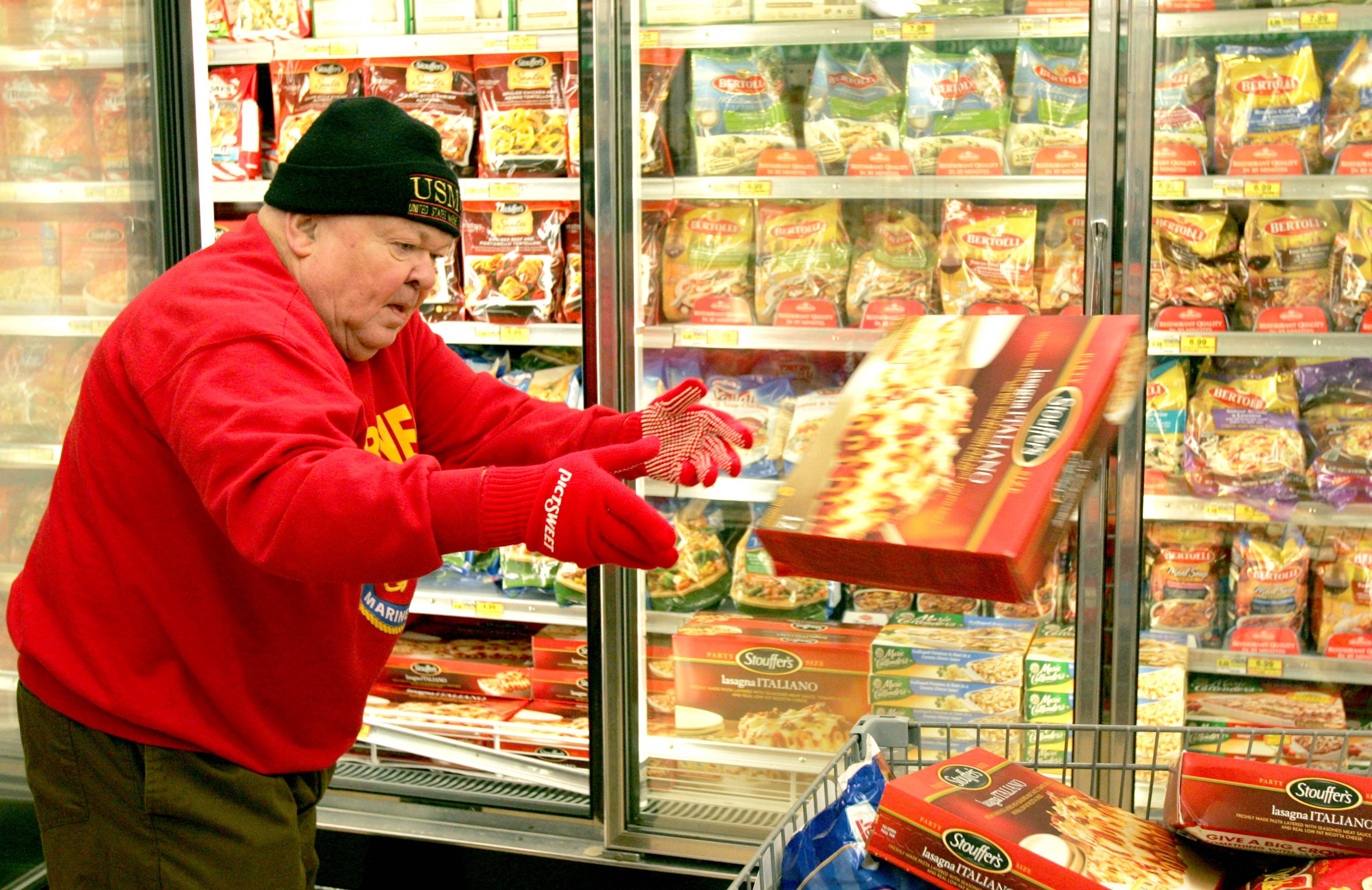 Pradel seldom said no to a fundraising opportunity to help area charities. Here, he races through a grocery store as part of a contest to raise money for a food pantry.