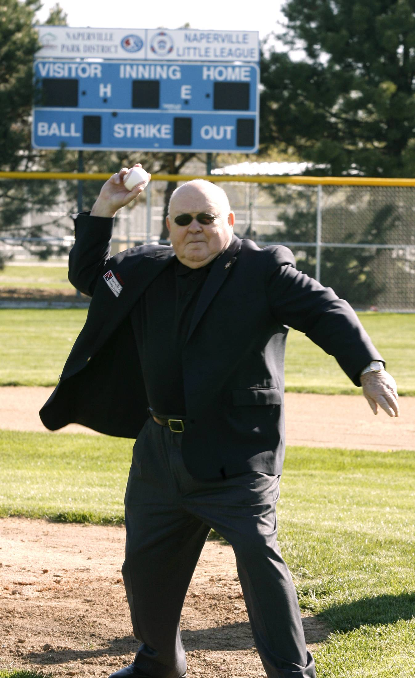 Pradel throws out the first pitch as Naperville Park District celebrates the opening of another Naperville Little League season.