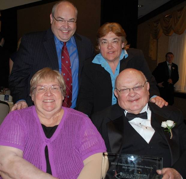 Pradel with his wife, Pat, and children Gary and Carol in May 2013 at a Naperville Jaycees Distinguished Service Award dinner.