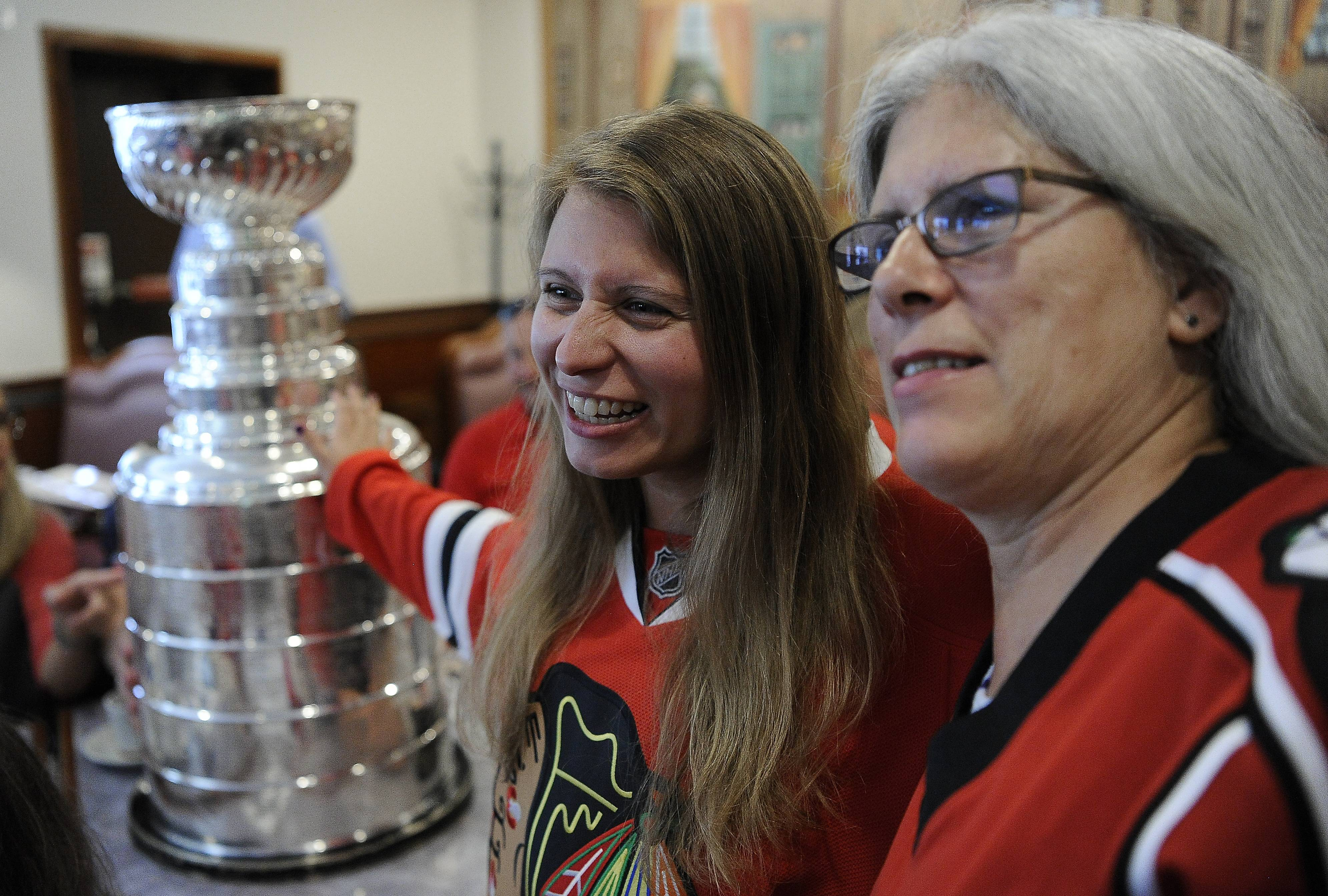 Erin Levine, 27, and her mother, Holli, both of Wheeling, get their picture taken Tuesday with the Stanley Cup at The Original Granny's restaurant in Wheeling.