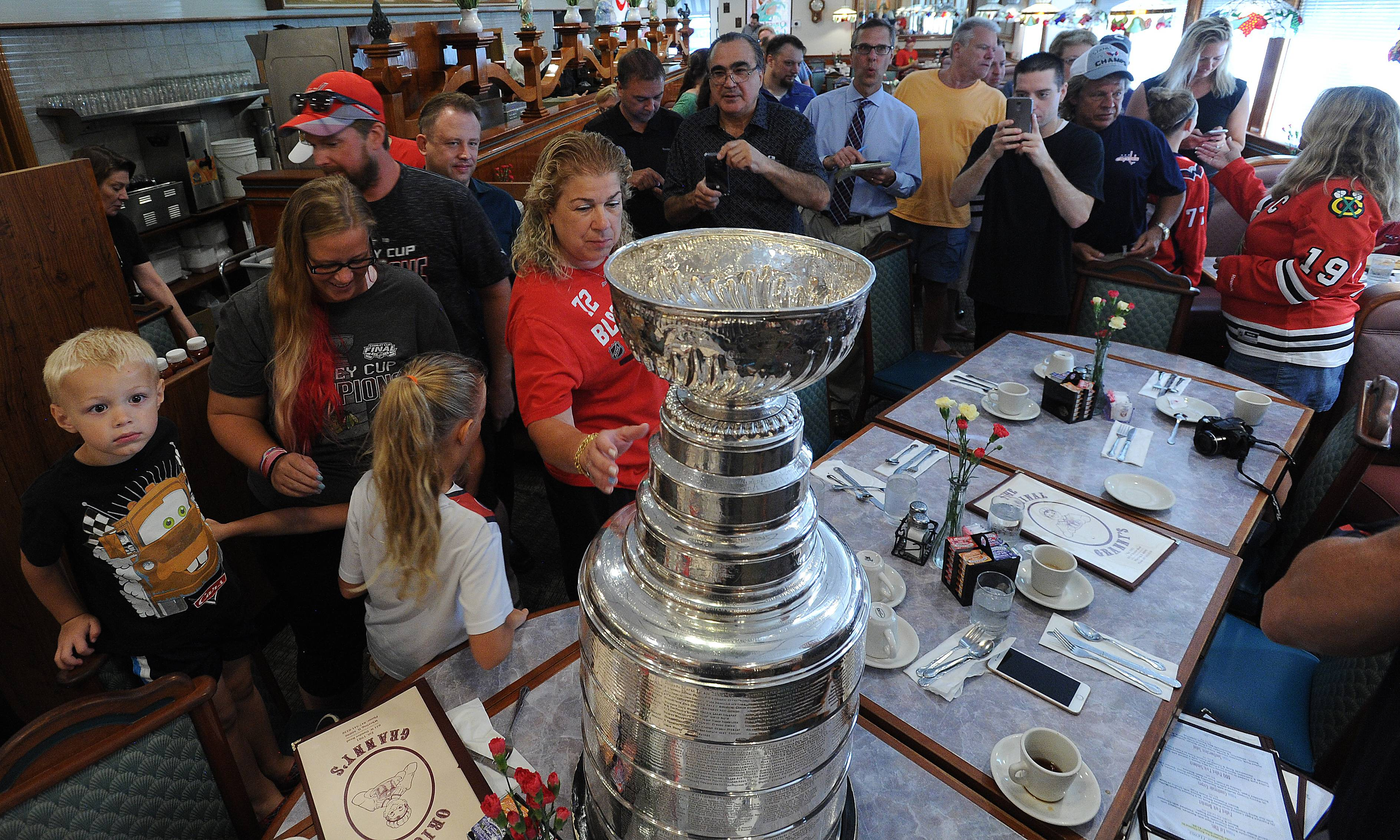 Diners at The Original Granny's restaurant in Wheeling enjoyed a festive atmosphere Tuesday morning as Lake Zurich resident Steve Richmond, director of player development for the Washington Capitals, spent part of his day there with the iconic trophy.