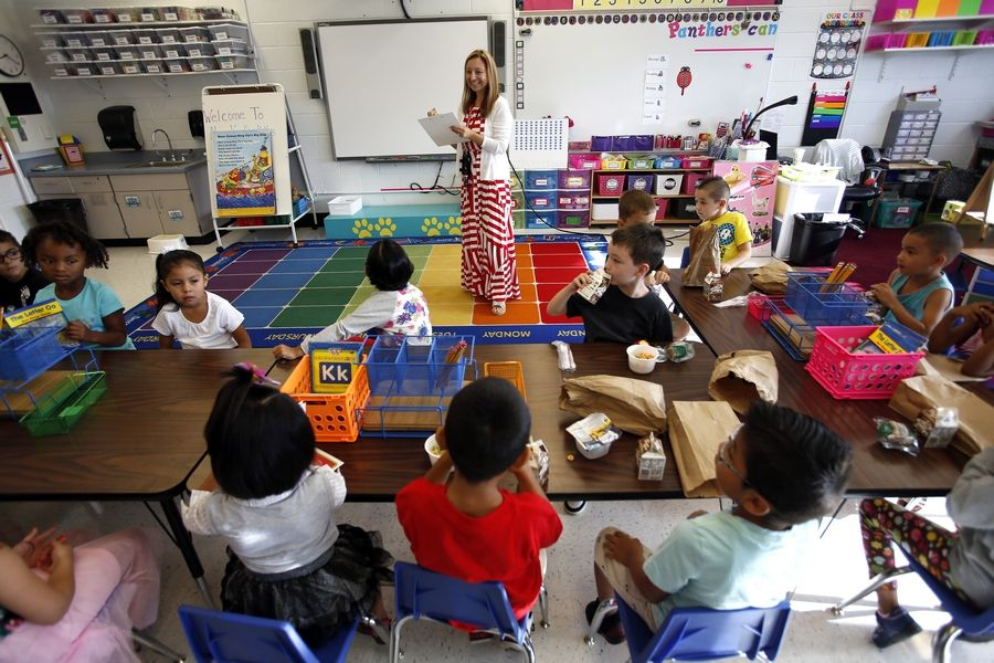 Grace Vanderkolk takes student attendance in a full-day kindergarten class at Parkview Elementary School in Carpentersville. Roughly 30 percent of incoming kindergartners at Algonquin-based Community Unit District 300 meet readiness bench marks, according to a state report.