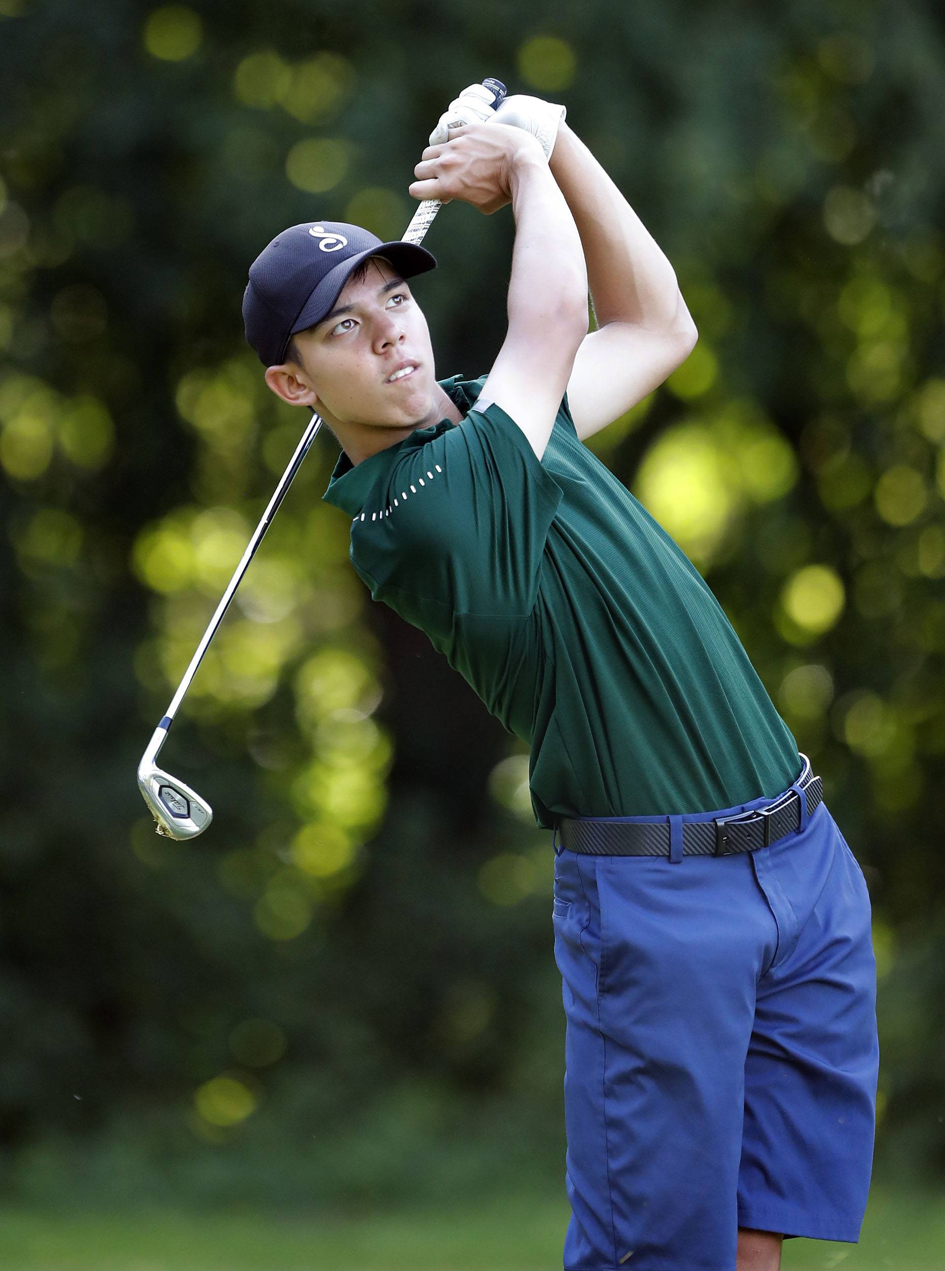 Stevenson's Jackson Bussell tee shot to the 4th hole during their match against Mundelein at Steeple Chase Golf Club Tuesday.