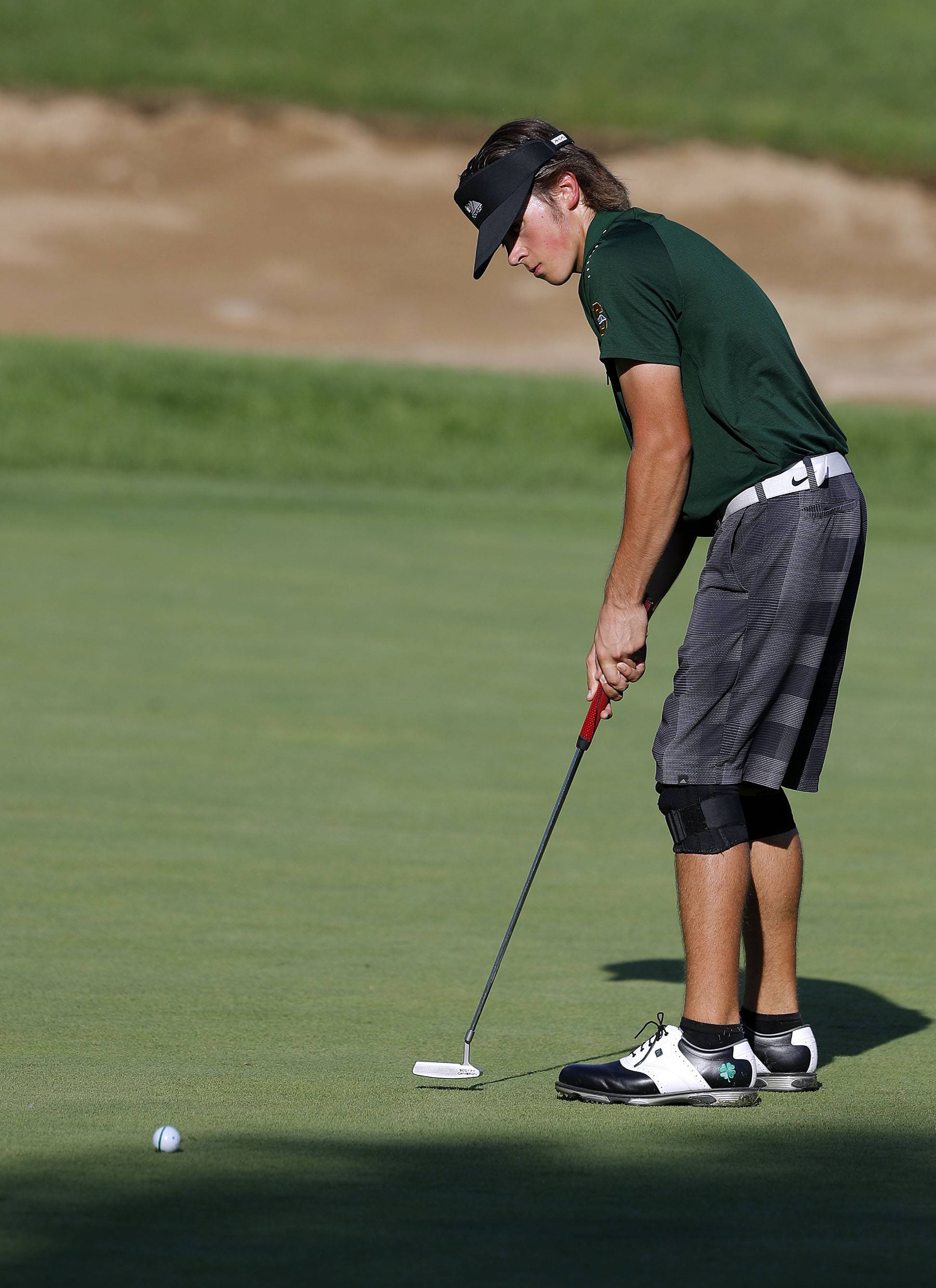 Stevenson's Mark Noonan puts on the 3rd green during their match against Mundelein at Steeple Chase Golf Club Tuesday.