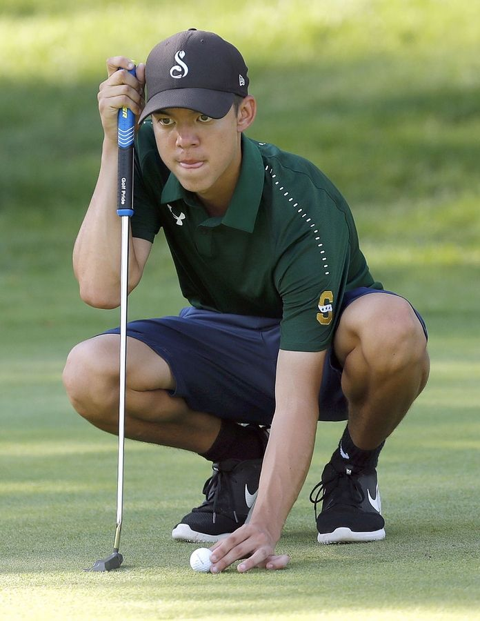 Stevenson's Jackson Bussell lines up a putt on the 4th hole during their match against Mundelein at Steeple Chase Golf Club Tuesday.