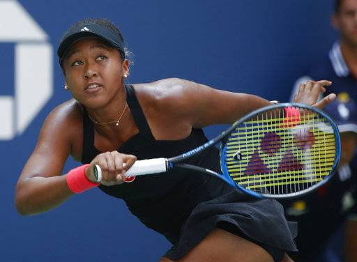 Naomi Osaka, of Japan, returns a shot to Lesia Tsurenko, of Ukraine, during the quarterfinals of the U.S. Open tennis tournament, Wednesday, Sept. 5, 2018, in New York.