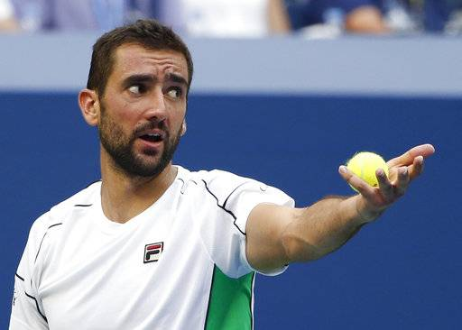 Marin Cilic, of Croatia, argues with the chair umpire during a match against Kei Nishikori, of Japan, in the quarterfinals of the U.S. Open tennis tournament, Wednesday, Sept. 5, 2018, in New York.