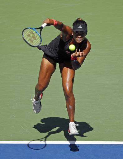 Naomi Osaka, of Japan, serves to Lesia Tsurenko, of Ukraine, during the quarterfinals of the U.S. Open tennis tournament, Wednesday, Sept. 5, 2018, in New York.