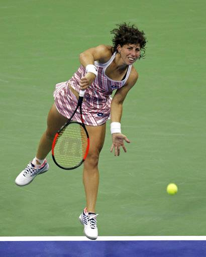 Carla Suarez Navarro, of Spain, serves to Madison Keys during the quarterfinals of the U.S. Open tennis tournament, Wednesday, Sept. 5, 2018, in New York.