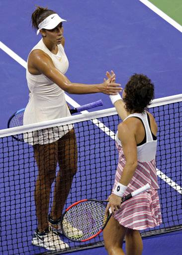 Madison Keys shakes hands with Carla Suarez Navarro, of Spain, after defeating her during the quarterfinals of the U.S. Open tennis tournament, Wednesday, Sept. 5, 2018, in New York.