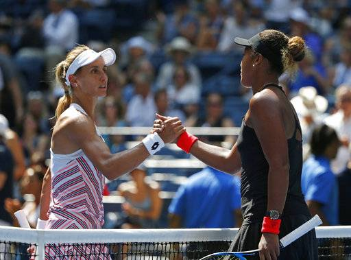 Naomi Osaka, right, of Japan, shakes hands with Lesia Tsurenko, of Ukraine, after Osaka defeated Tsurenko during the quarterfinals of the U.S. Open tennis tournament, Wednesday, Sept. 5, 2018, in New York.