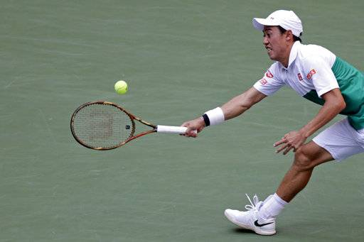 Kei Nishikori, of Japan, returns a shot to Marin Cilic, of Croatia, during the quarterfinals of the U.S. Open tennis tournament, Wednesday, Sept. 5, 2018, in New York.