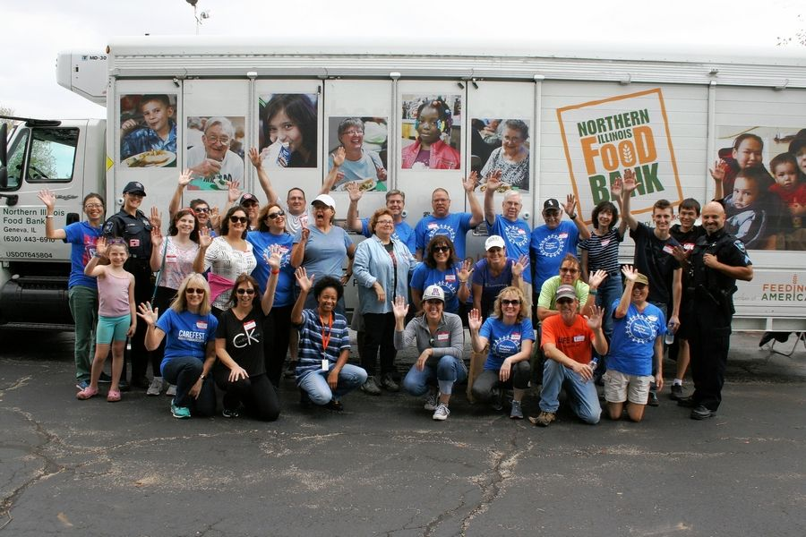 "A group called ""Neighbors Helping Neighbors"" will head a mobile food distribution for Wayne Township food pantry clients from 10 a.m. to noon Saturday in West Chicago."