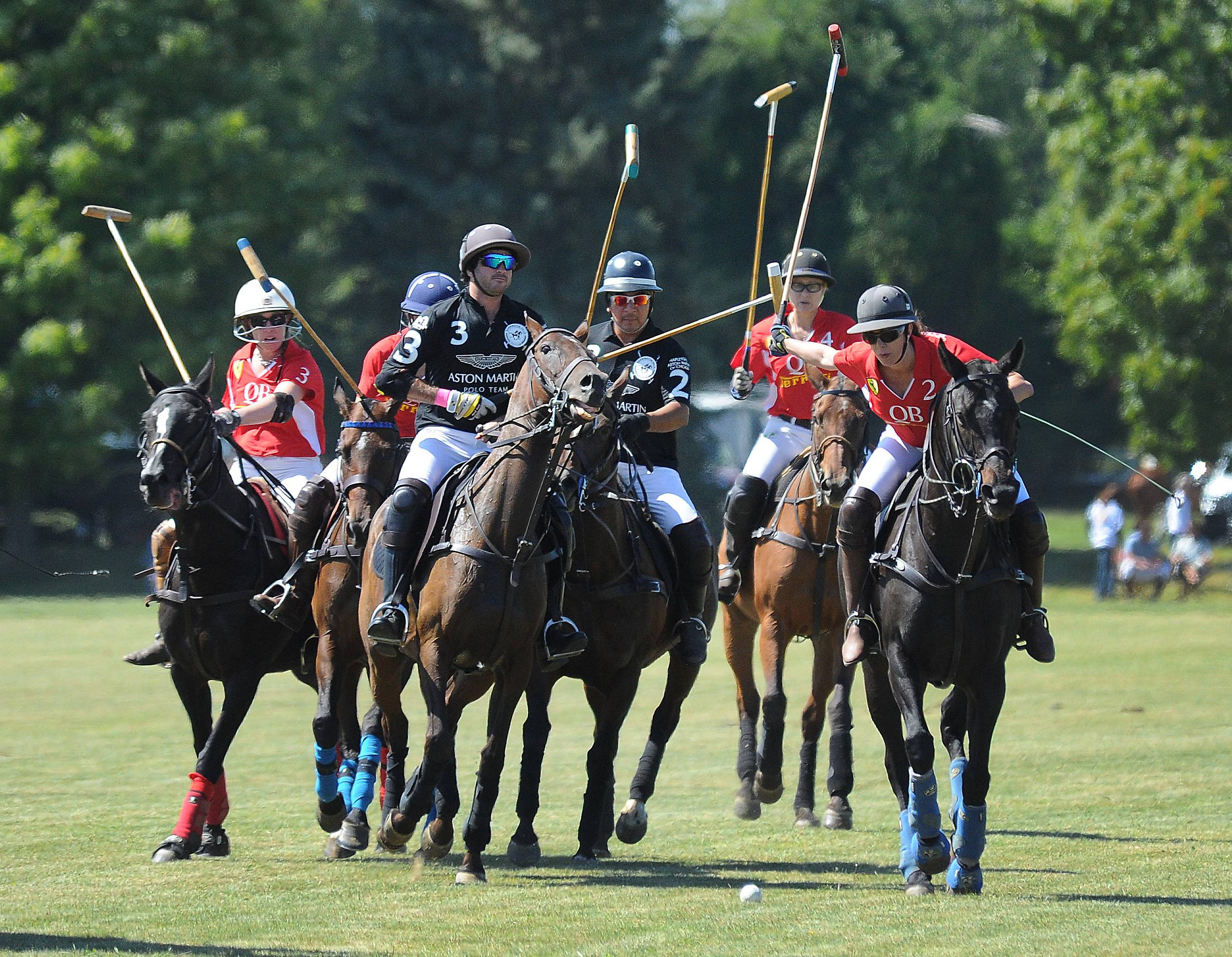 The Aston Martin Polo Team (men) and the Quintessential Barrington Polo Team (women) play at the 13th annual LeCompte/Kalaway Trailowners Cup Polo in Barrington Hills.
